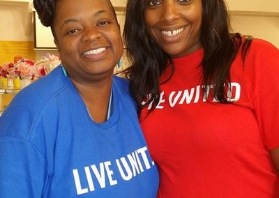 Directory of Health and Family Services Jacqualine Boles and Voulnteer from the United Way Day of Careing